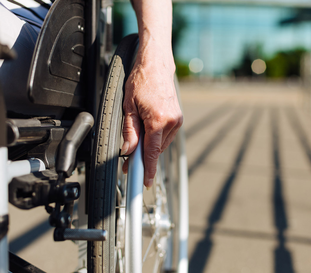Person with disabilities using wheelchair