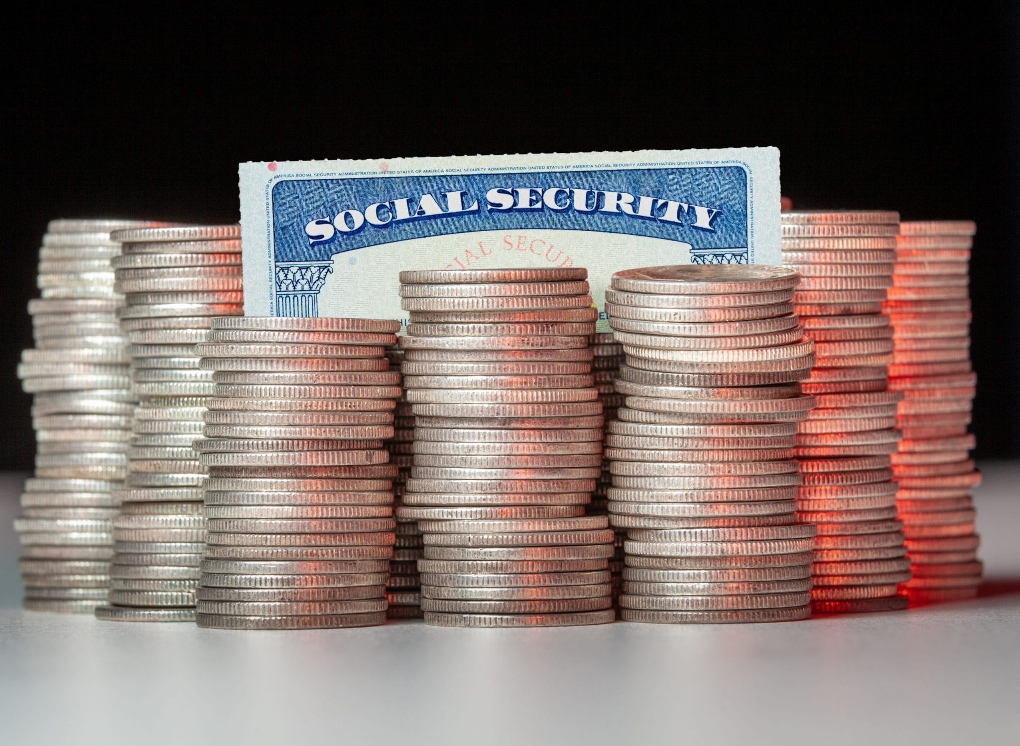 social-security-card-in-stack-of-silver-coins