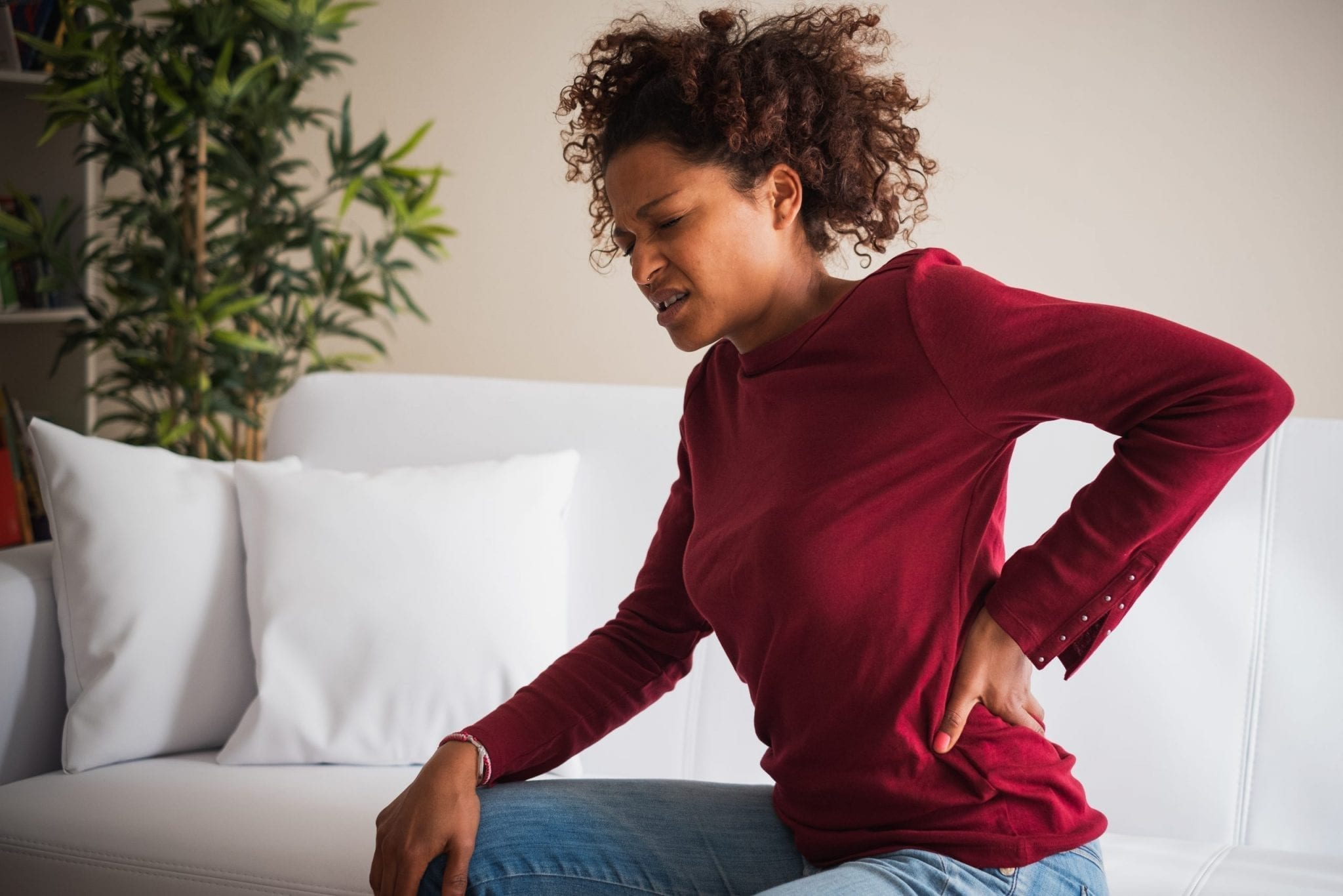 Young black woman suffer back pain cramp