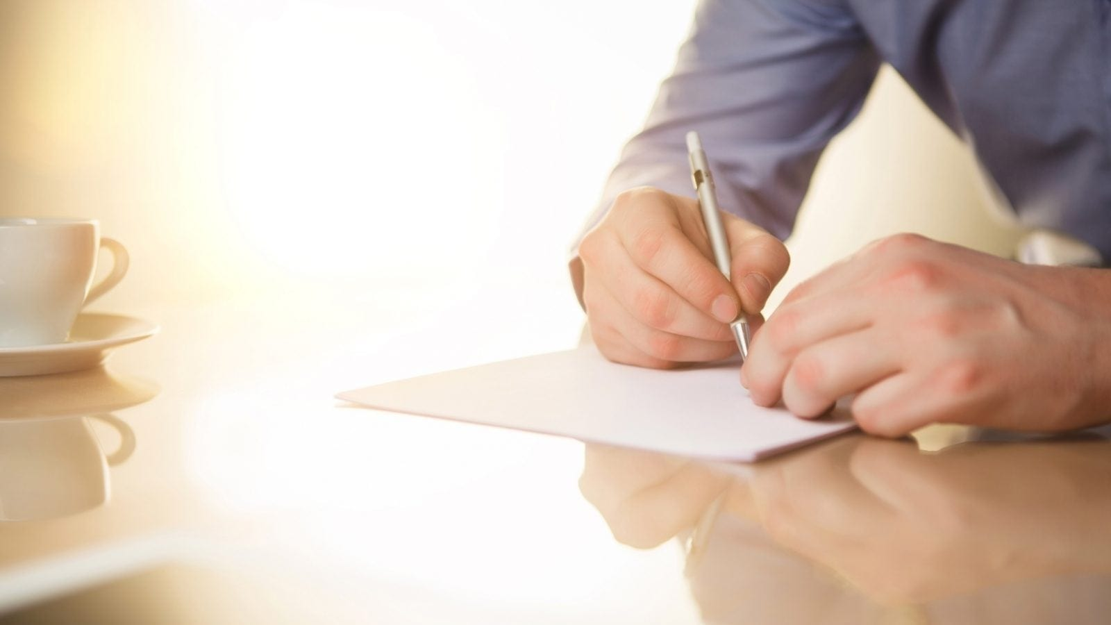 Male Signing Document Stock Photo