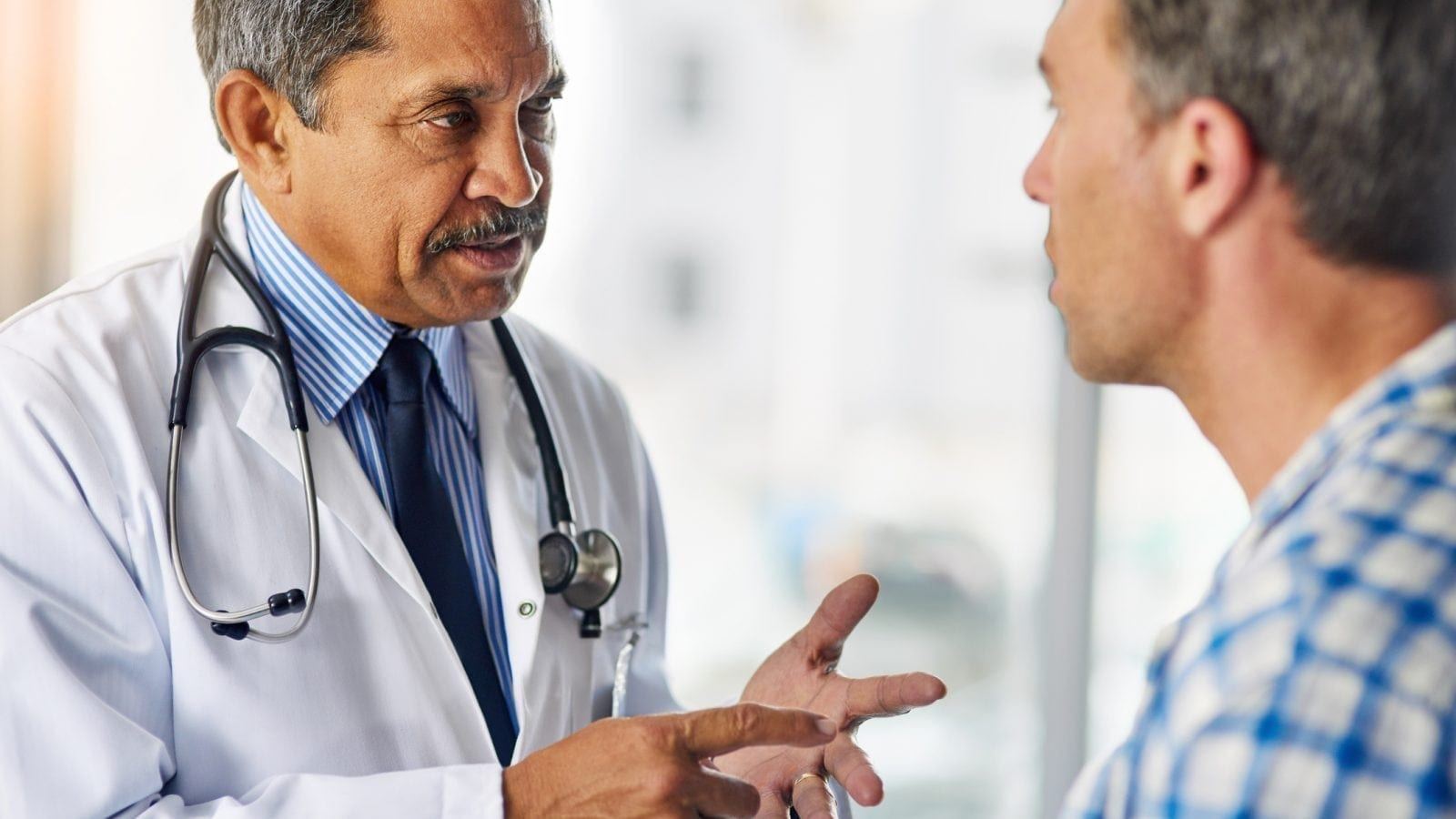 Doctor Giving Advice Stock Photo