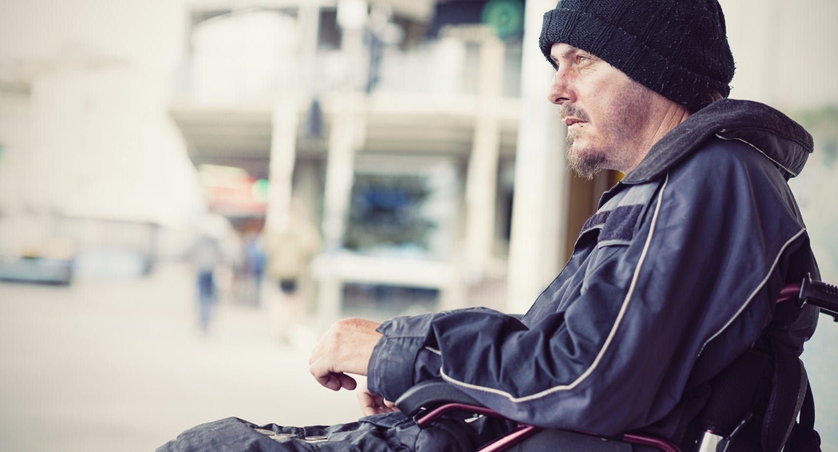 Homeless Man In A Wheelchair Stock Photo