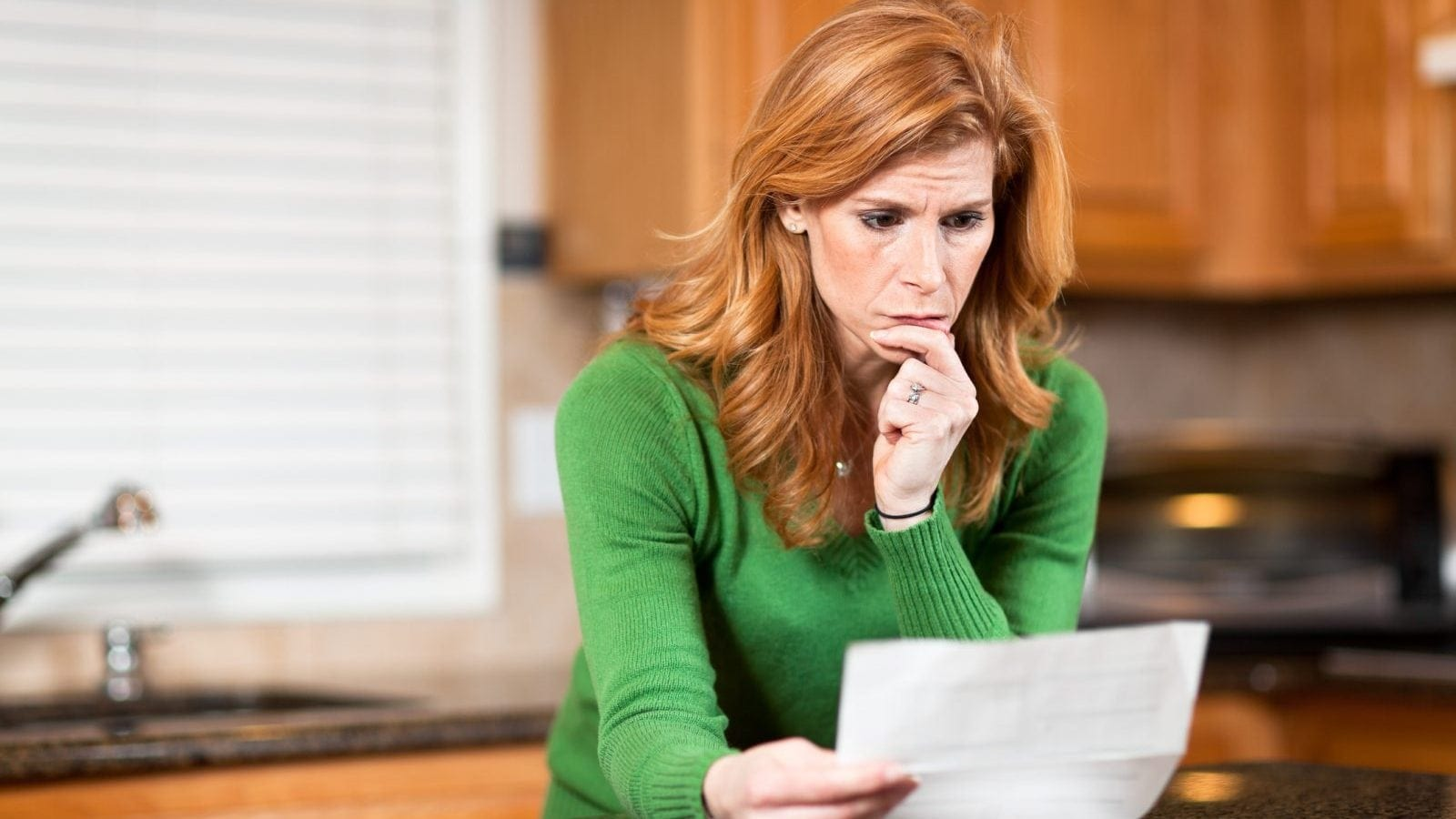 Woman Reading Denial Letter Stock Photo