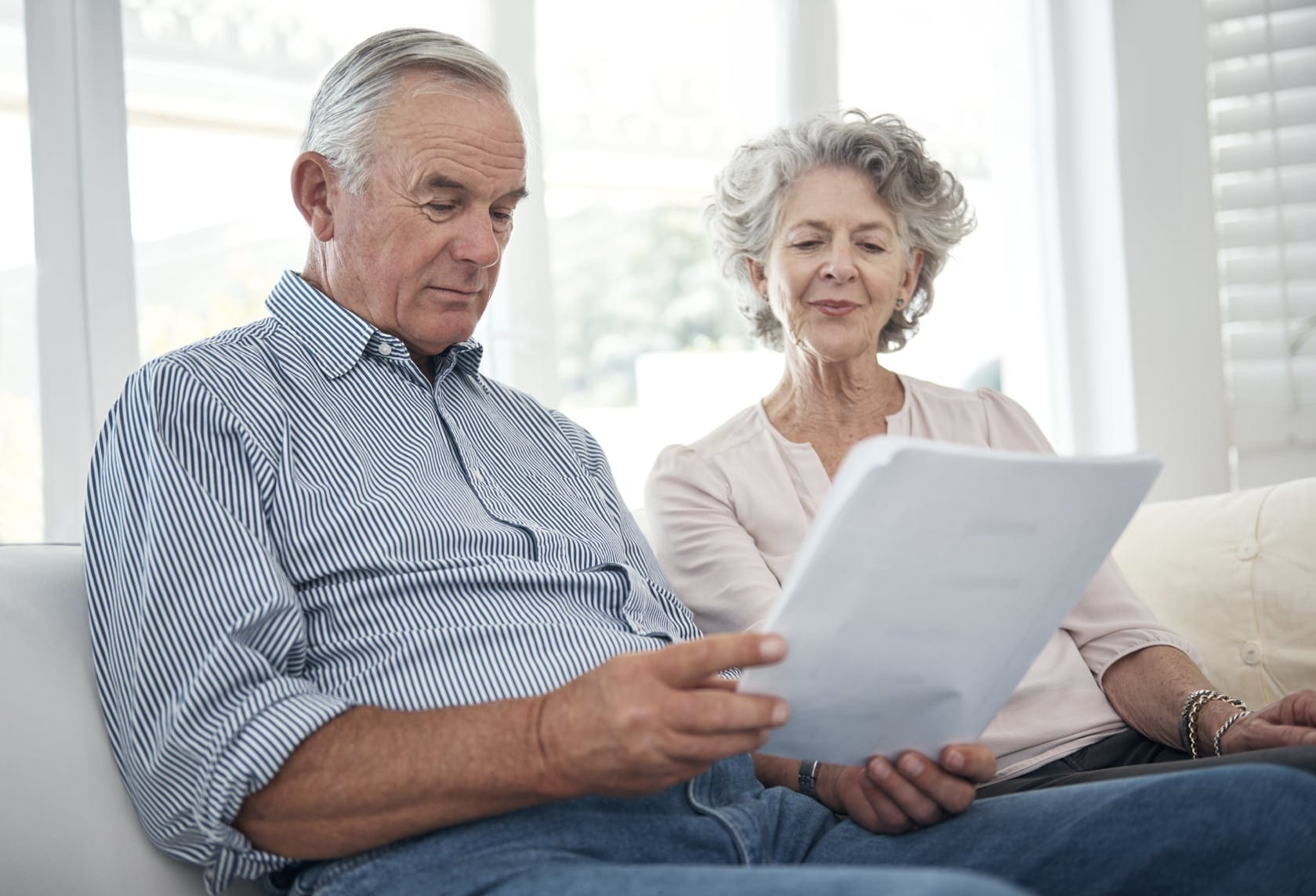 Elderly Couple Examining Social Security Documents