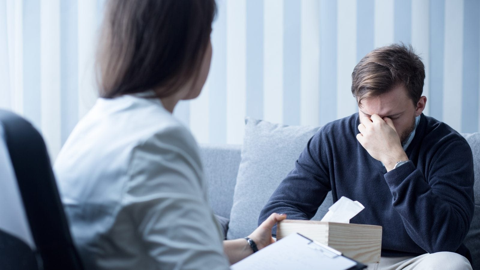 Female Counselor Helping Depressed Man