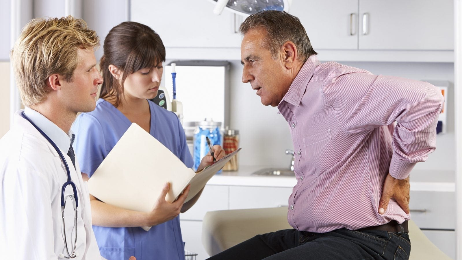 Back Pain Doctor's Office Stock Photo