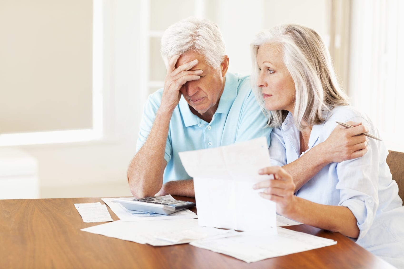 Senior Couple Reviewing Bills Stock Photo