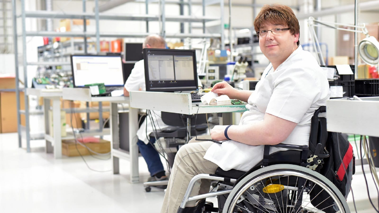 Handicapped Worker In A Wheelchair Stock Photo