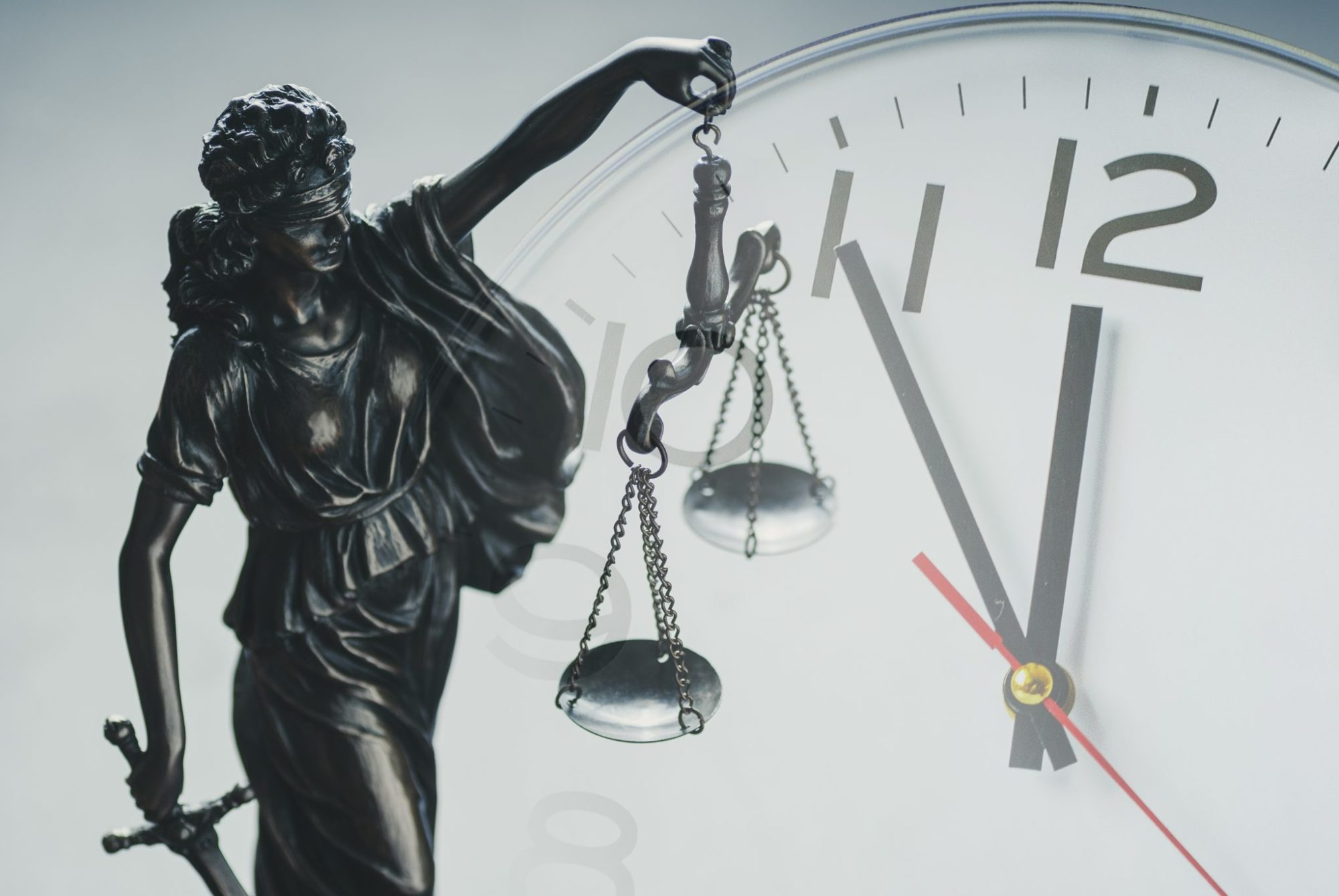 Justice holding the scales of justice and law