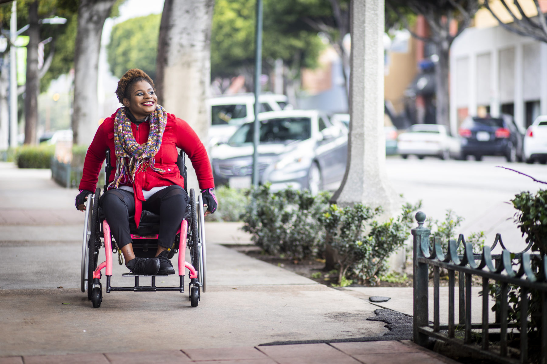 a woman in a wheelchair on the sidewalks of Los Angeles