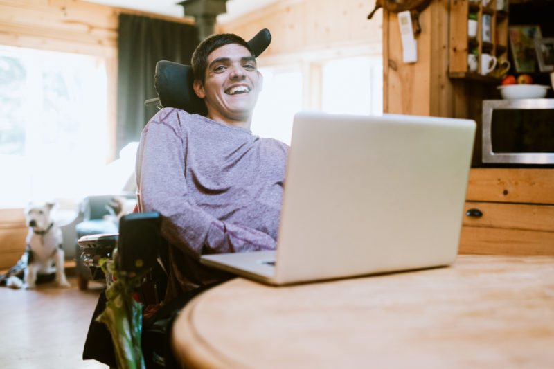 a disabled man checking on the status of his disability benefits