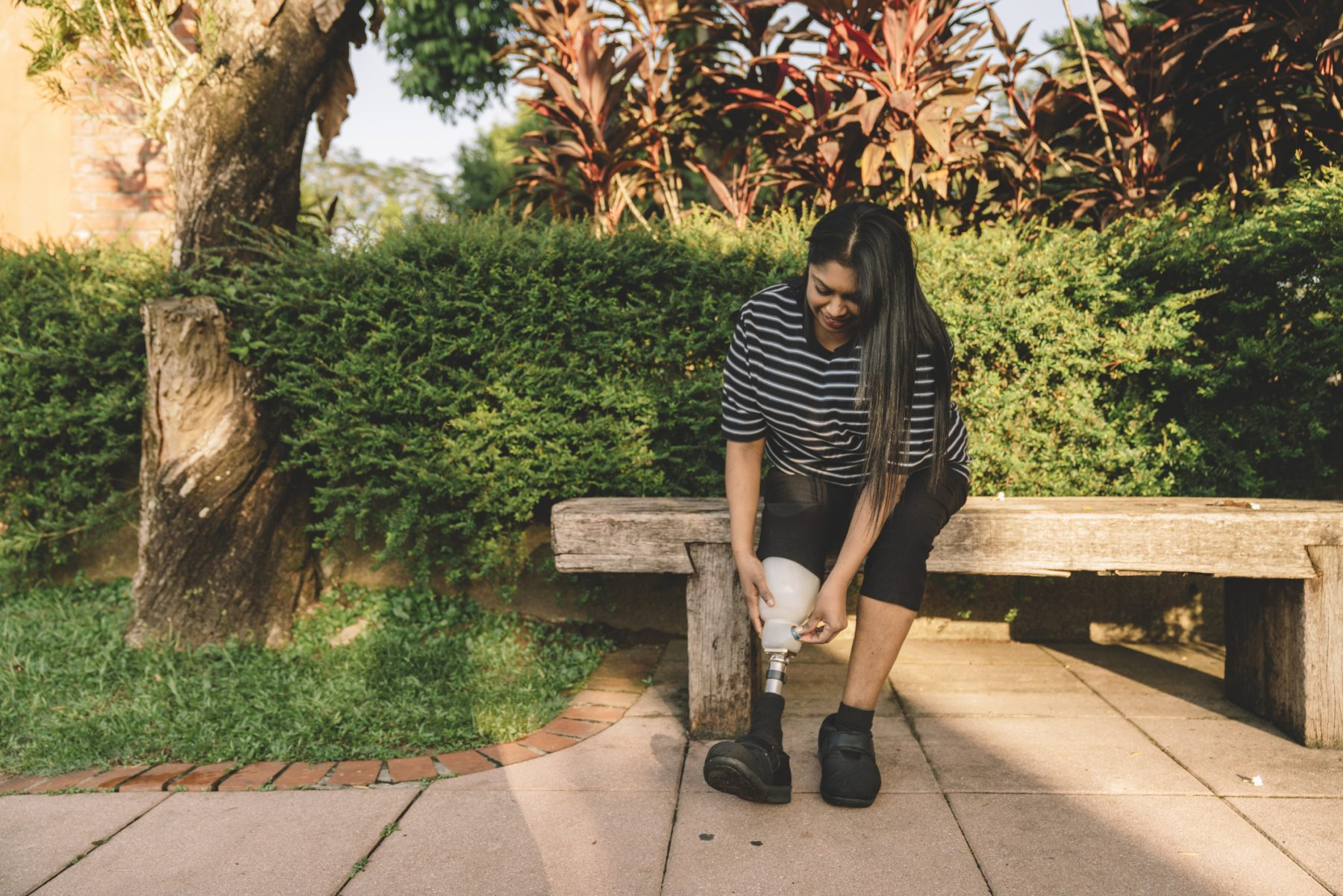 A woman with a prosthetic leg taking a walk in Los Angeles