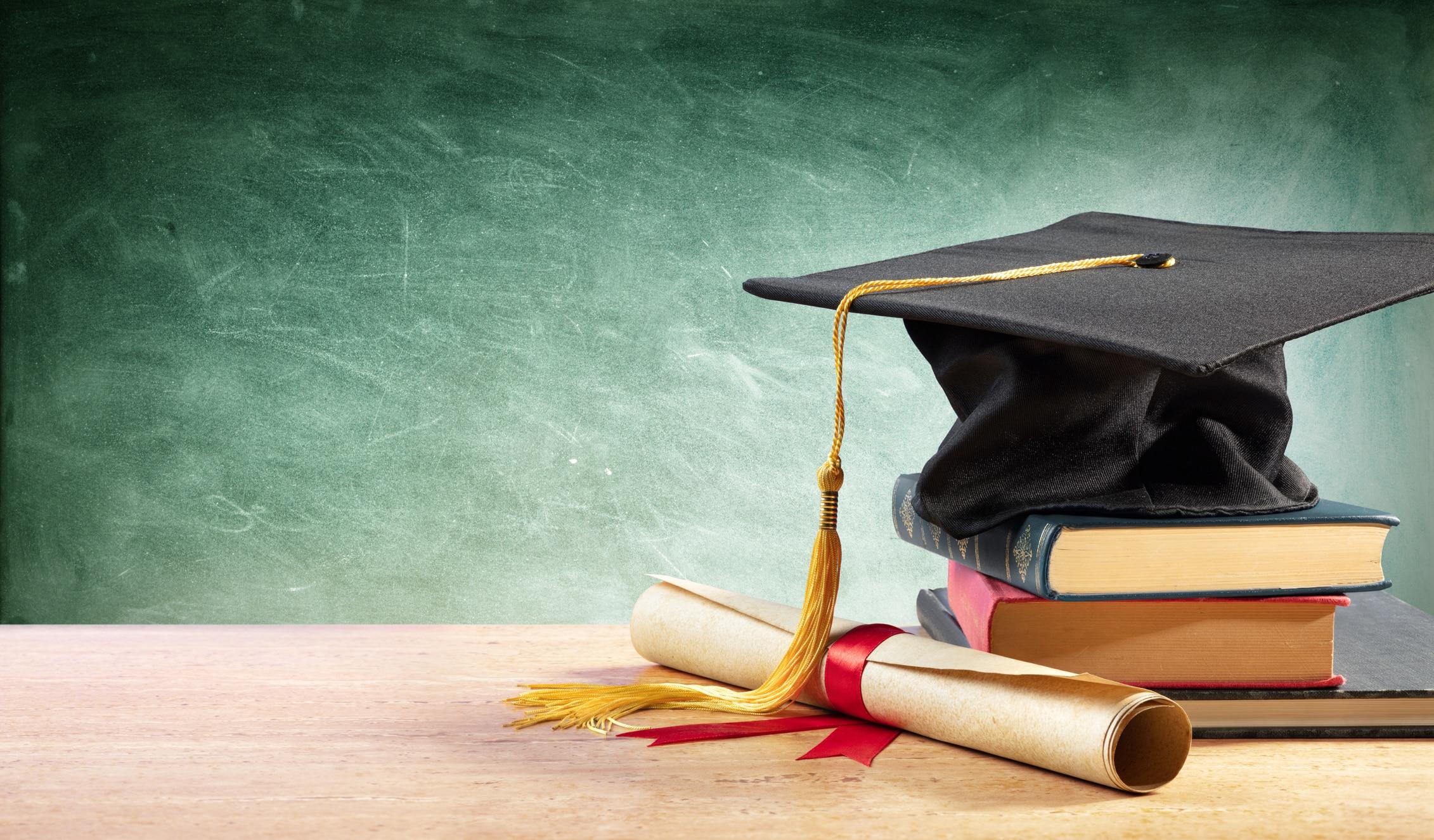 A graduation cap and a diploma.